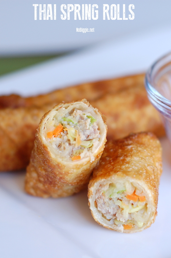 Thai Spring Rolls made with ground Pork, matchstick cut carrots, sliced cabbage and thinly sliced onion all wrapped up and fried until golden. Dip them in sweet chili sauce, and you have the perfect appetizers to feed a crowd. #thaispringrolls #nobiggierecipes