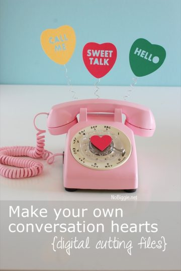 Conversation heart cut outs plus a pink rotary phone