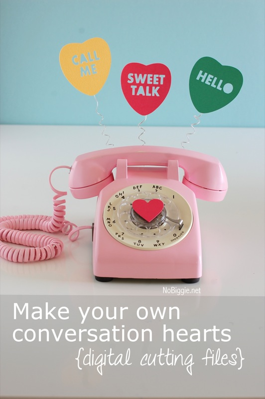 Conversation heart cut outs plus a pink rotary phone makes for an adorable Valentine\'s Day decor piece that will have people talking. #rotaryphone #valentinesday #valentinesdaydecor #upcycle #conversationhearts
