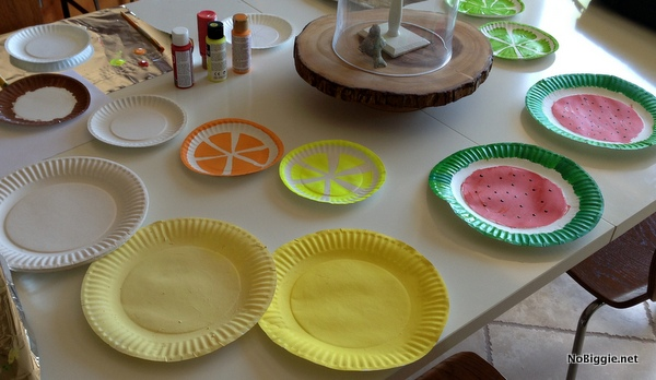 paint paper plate to look like cut fruit - More ideas for a Fruit Ninja party via NoBiggie.net