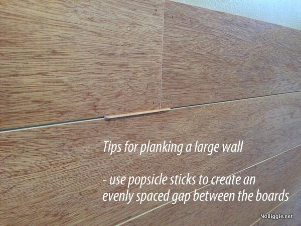 Use a popsicle stick to help space boards for a planked wall - NoBiggie.net
