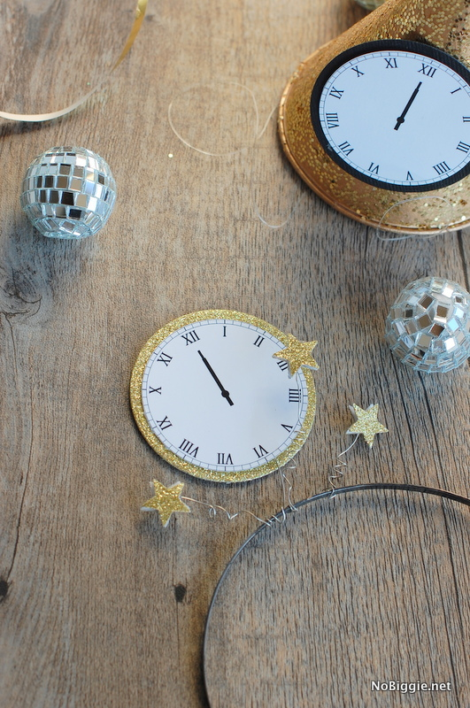 Make a fun headband to Celebrate New Year's Eve with this free printable - midnight clocks - via NoBiggie.net