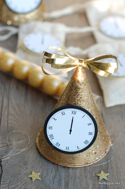 party hats to celebrate new years eve with this free printable midnight clocks via