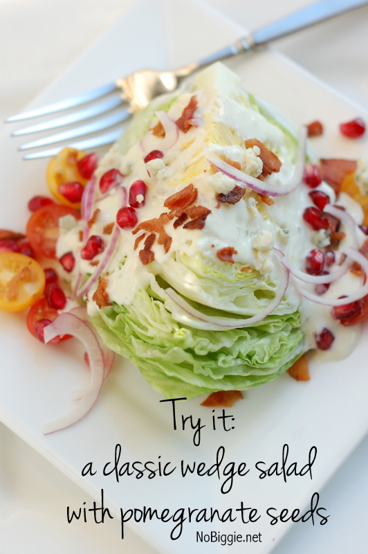 the best blue cheese salad dressing on a classic wedge with pomegranate seeds | NoBiggie.net