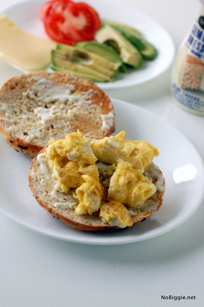 add the seasoned scrambled eggs to the sandwich