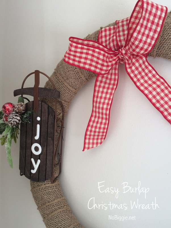 Burlap Christmas Wreath - an easy wreath to add to your Christmas decor. #burlap #christmas #burlapchristmaswreath #christmaswreath #diywreaths #michaels