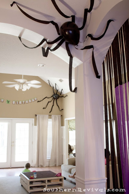 Crepe paper spiders | 25+ Halloween party decor ideas