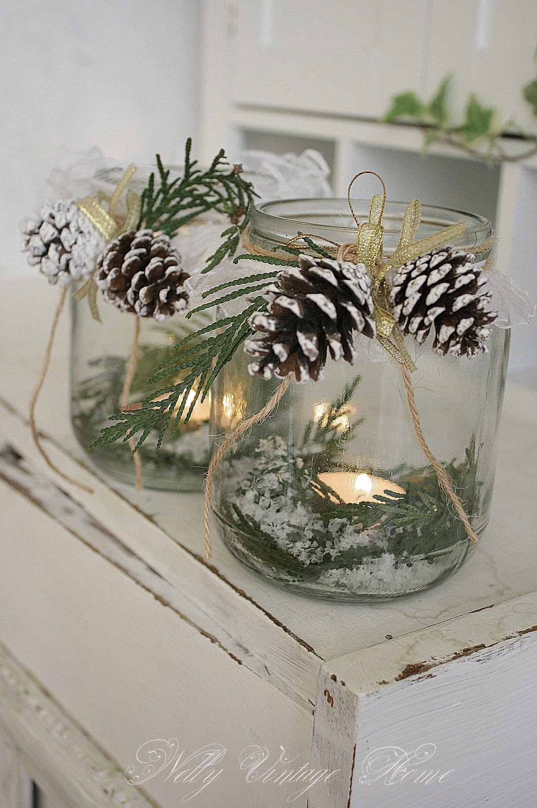 Tea light in a jar with greens