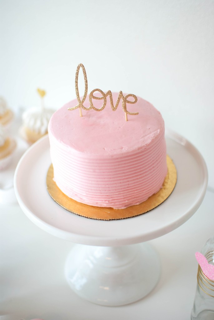 Gold glitter LOVE on pink cake