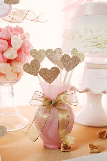 Gold hearts in a pink vase