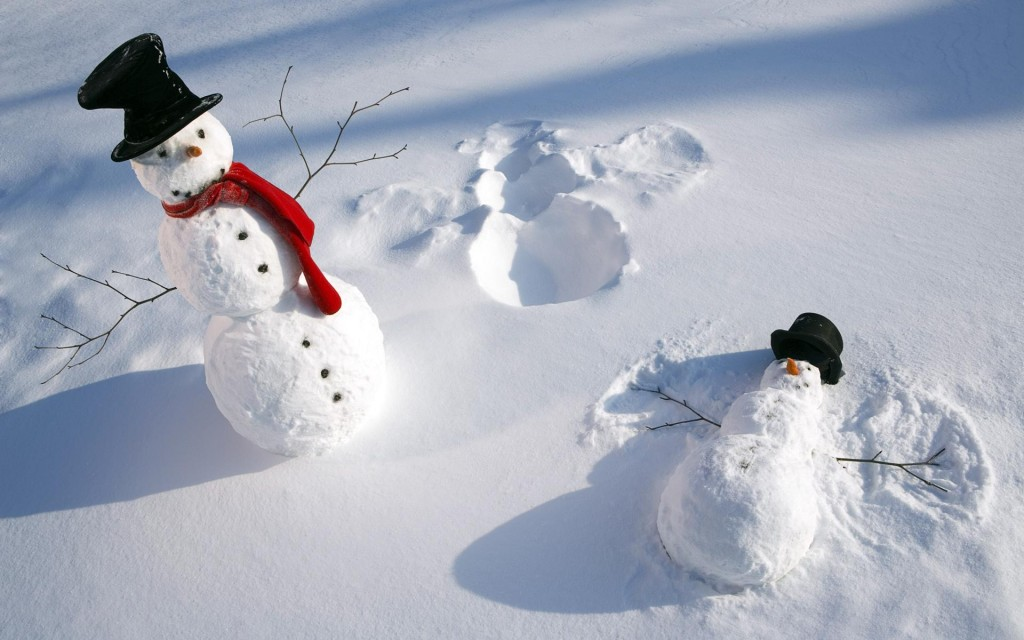 Snowmen doing snowangels
