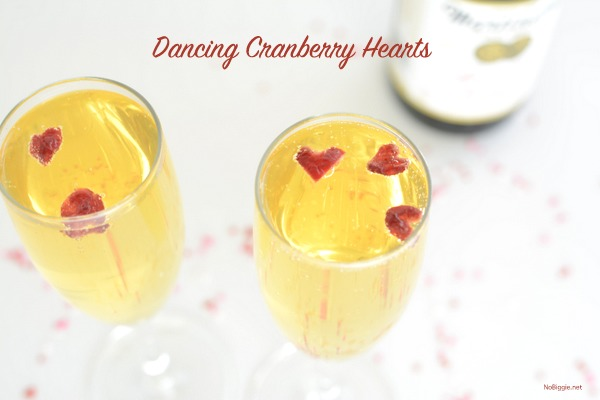Watch tiny cranberry hearts dance in champagne bubbles.