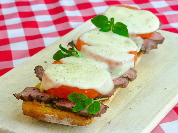 http://www.nobiggie.net/wp-content/uploads/2016/02/Tomato-Provolone-Steak-Sandwich-25-leftover-steak-recipes.jpg