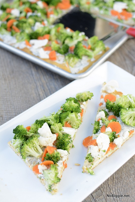 Easy Veggie Pizza | Crescent crust topped with ranch dip mixture then loaded with veggies. Perfect cold bite sized appetizer. | NoBiggie.net