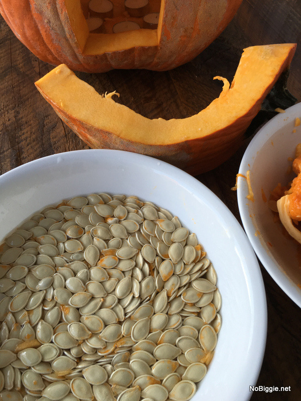 cleaning off the pumpkin seeds | NoBiggie.net