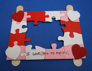 Puzzle Piece Picture Holder | 25+ Valentine Crafts for Kids