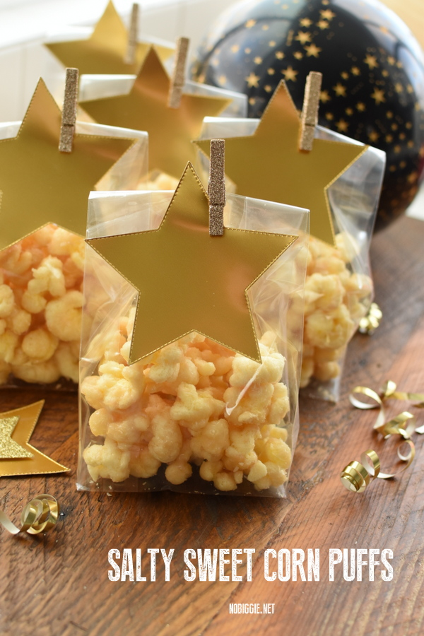 Salty Sweet Corn Puffs are the ultimate sweet and salty, melt in your mouth and crunchy snack all at the same time. We love them during the holidays. #ChestersPuffCornCrack #PuffedCornAKACrackCorn #CandiedCornPops #saltysweet #puffedcorntreat