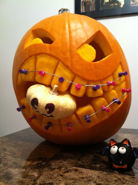 Braces and Baby Carved Pumpkin | 25+ Creative Carved Pumpkins