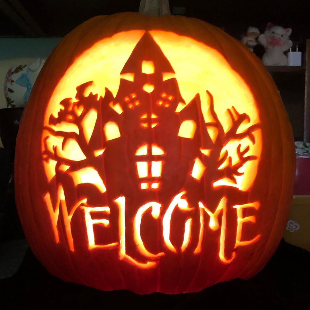 Haunted House Welcome Carved Pumpkin | 25+ Creative Carved Pumpkins