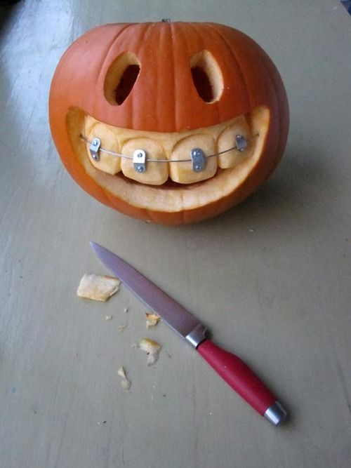 Smiley Braces Carved Pumpkin | 25+ Creative Carved Pumpkins